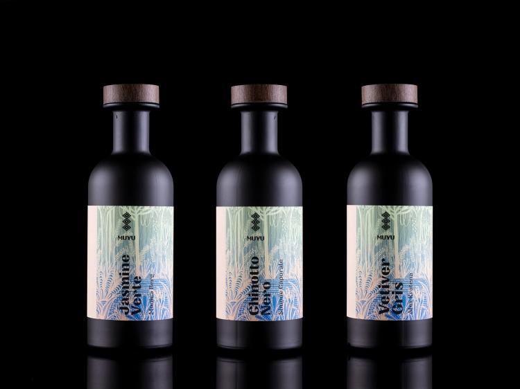 3-bottles-black-bacground-closer-together_web